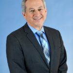 Providing Support, Development, & Education to Those in Need | Dr. Michael Olenick